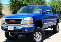 File photo: Bright blue 2004 GMC Sierra pickup truck