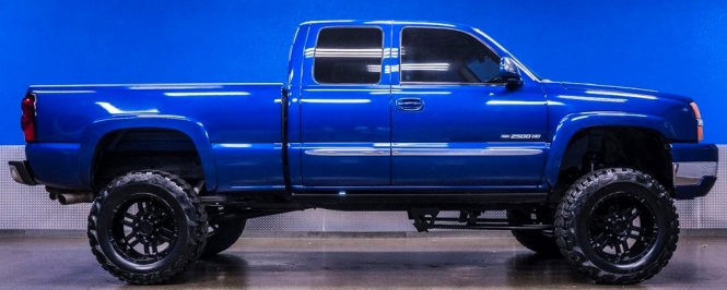 bright blue 2004 GMC Sierra pickup truck