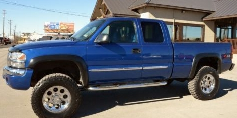 bright blue 2004 GMC Sierra pickup truck 3